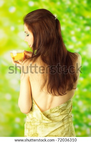 Beautiful Girl Drinking Healthy Green Tea. Healthcare or Herbal medicine concept - stock photo
