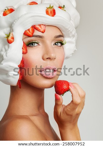 beautiful girl, eat dessert. Strawberries and cream - stock photo