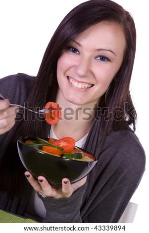 Beautiful Girl Eating Salad - Isolated Close up - stock photo