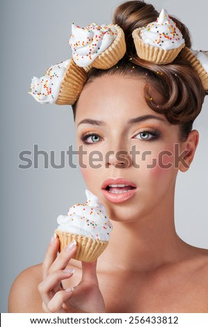 beautiful girl eats cake - stock photo