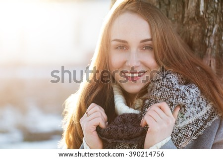 Beautiful girl enjoying her time outside in winter park - stock photo