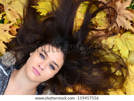 Beautiful girl enjoying nature in autumn forest