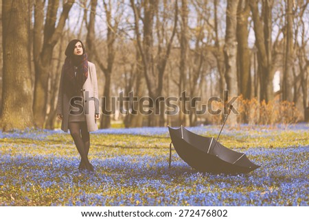 Beautiful girl enjoys spring time in the park - stock photo