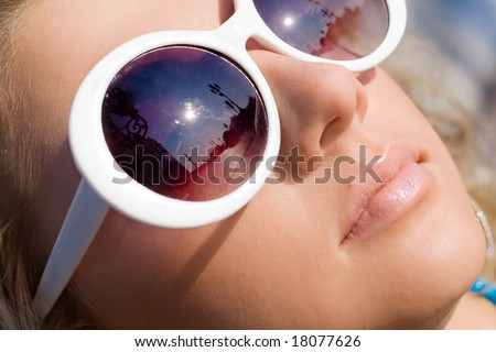 Beautiful girl face in big white sun glasses - stock photo