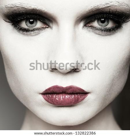 beautiful girl fashion studio portrait on dark background - stock photo