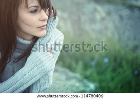 Beautiful girl freezing outdoor, autumn, cold, blue - stock photo