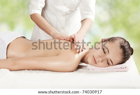 Beautiful girl getting a massage - stock photo
