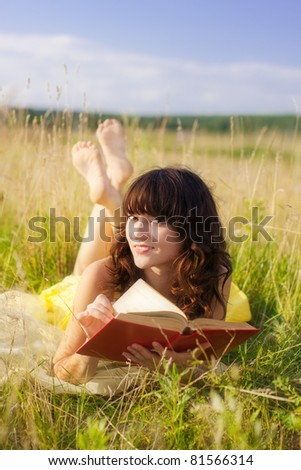 beautiful girl girl with book outdoor - stock photo