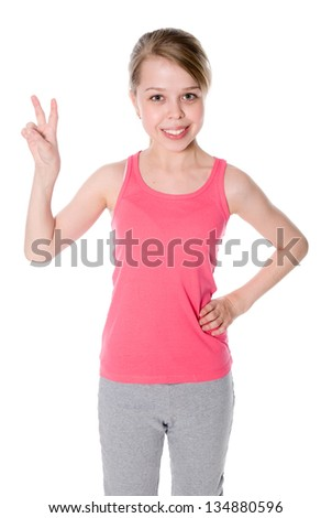 Beautiful Girl Giving Victory Sign Over A White Background