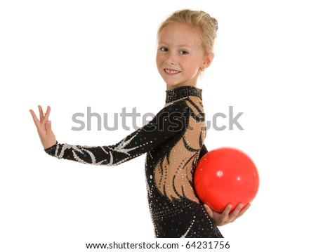 Beautiful girl gymnast with a ball