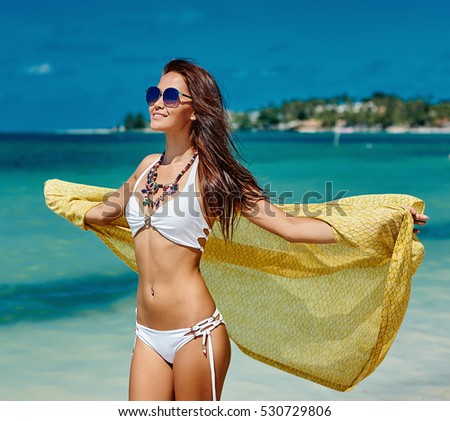 Beautiful girl having a good time on a summer beach