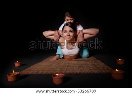 Beautiful girl having thai massage. - stock photo