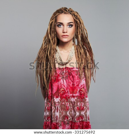 beautiful girl hippies with dreadlocks. pretty young woman with braids African hairstyle - stock photo