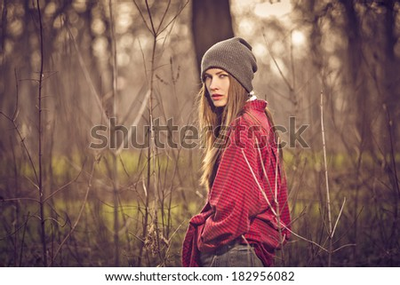 Beautiful girl hipster in the evening in the forest. toned - stock photo