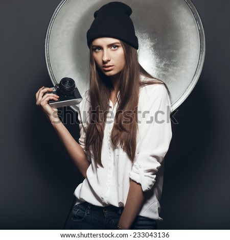 Beautiful girl hipster photographer - stock photo