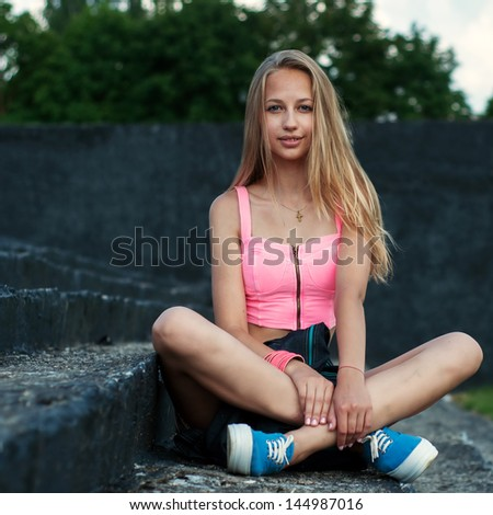 beautiful girl hipster sitting on the steps - stock photo