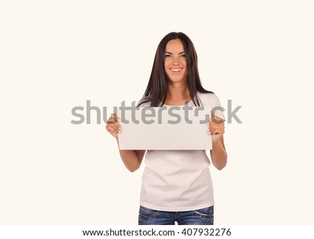 Beautiful girl holding a blank billboard isolated on white background