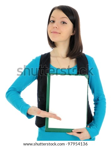 Beautiful girl holding a blank white piece of paper in front of her.