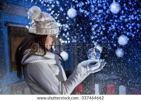 beautiful girl holding a Boule-de-neige - stock photo