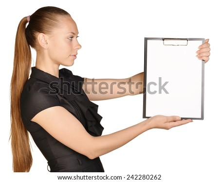 Beautiful girl holding a clipboard in hand and showing blank white paper - stock photo