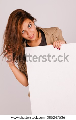 Beautiful girl holding a white board