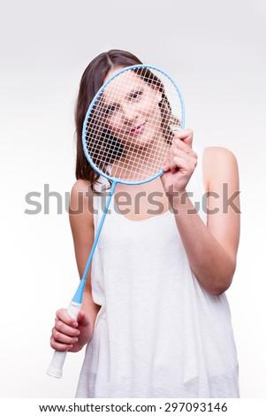 beautiful girl holding badminton racket - studio shot - stock photo