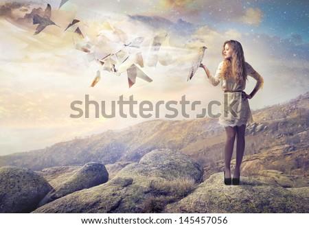 beautiful girl holding eagle - stock photo