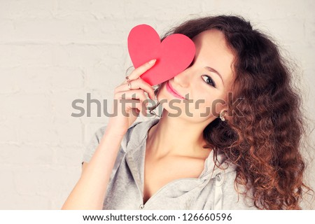 Beautiful girl holding heart shape - stock photo