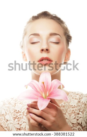 Beautiful girl holding lily flower in her hands