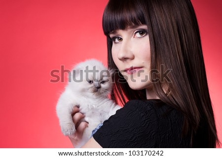 beautiful girl  holding little white kitten