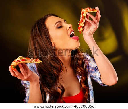Beautiful girl holding piece of pizza. Fastfood concept. - stock photo
