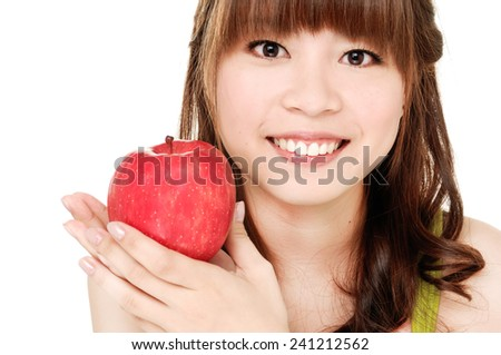 beautiful girl holding red apple - stock photo
