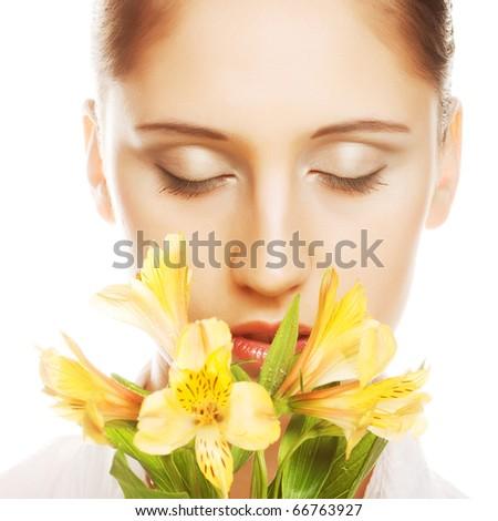 Beautiful girl holding yellowflowers in her hands - stock photo