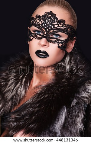 beautiful girl in a black mask - stock photo