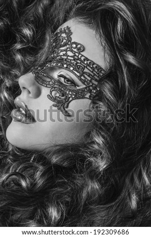 Beautiful Girl in a Carnival mask. Masquerade.Back and white beauty portrait redhead girls.Girl with lush hair.Ginger hair.Woman with voluminous hair - stock photo