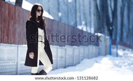 Beautiful girl in a coat and glasses art