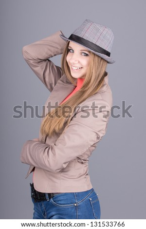 Beautiful girl in a hat smiling