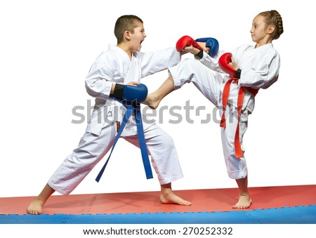 Beautiful girl in a kimono hits foot guy in the stomach  - stock photo