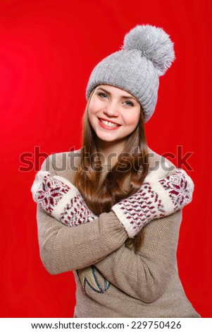 Beautiful girl in a knitted hat and gloves - stock photo
