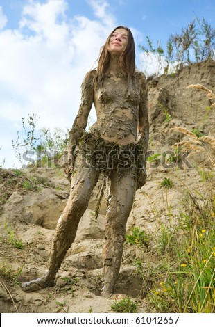 beautiful girl in a loincloth and a very dirty - stock photo