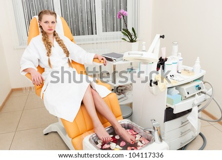 beautiful girl in a modern beauty salon - stock photo
