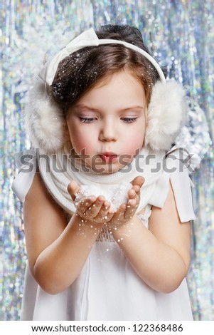 Beautiful girl in a New Year decorations - stock photo