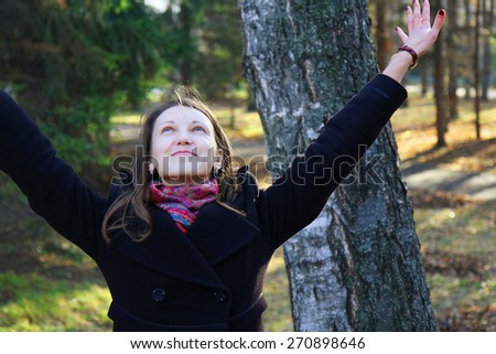 beautiful girl in a park on an autumn-day - stock photo
