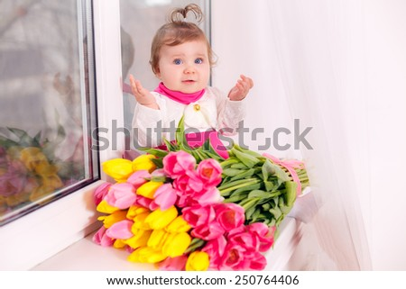 beautiful  girl in a pink dress with a bouquet of tulips. March 8 Mother's Day - stock photo