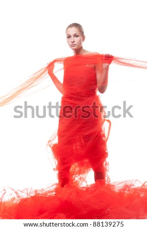 Beautiful girl in a red cloth studio shooting - stock photo