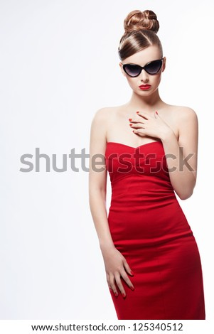 Beautiful girl in a red dress on a white background - stock photo