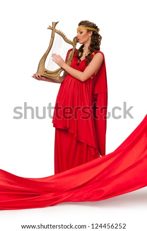 beautiful girl in a red dress with a harp in his hands. Isolated background - stock photo