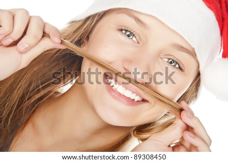 beautiful girl in a Santa Claus hat, a beautiful white teeth smile - stock photo