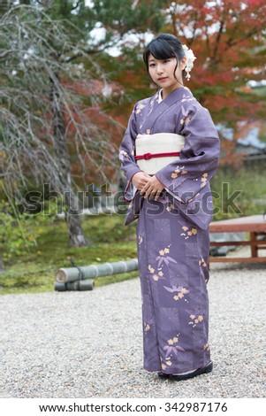 Beautiful girl in a seasonal kimono - stock photo