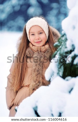 beautiful girl in a snowy forest - stock photo